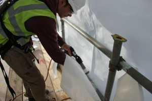 Using raptor heat gun to weld scaffold wrap sheeting