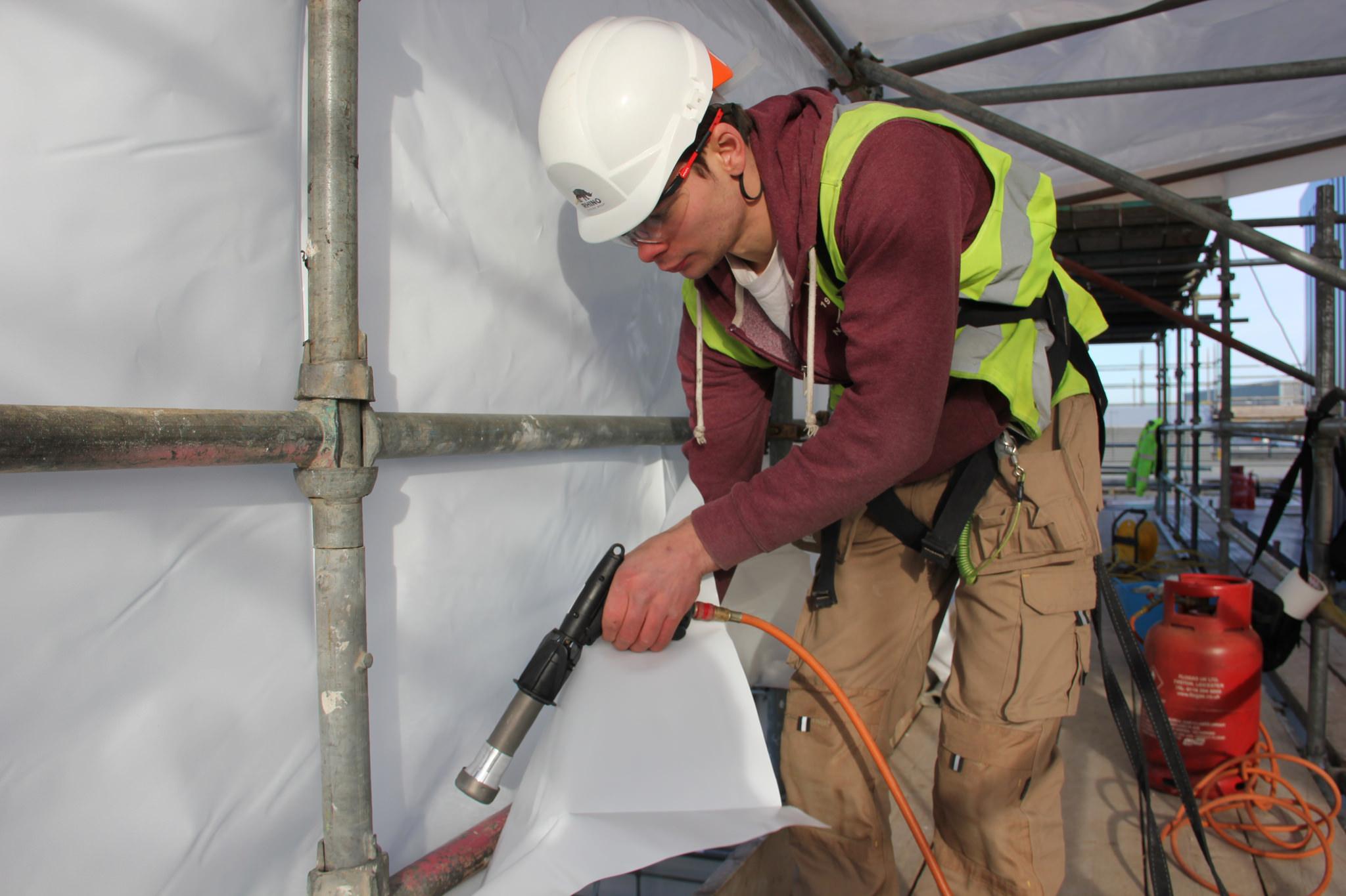 Welding shrink wrap around scaffold tube