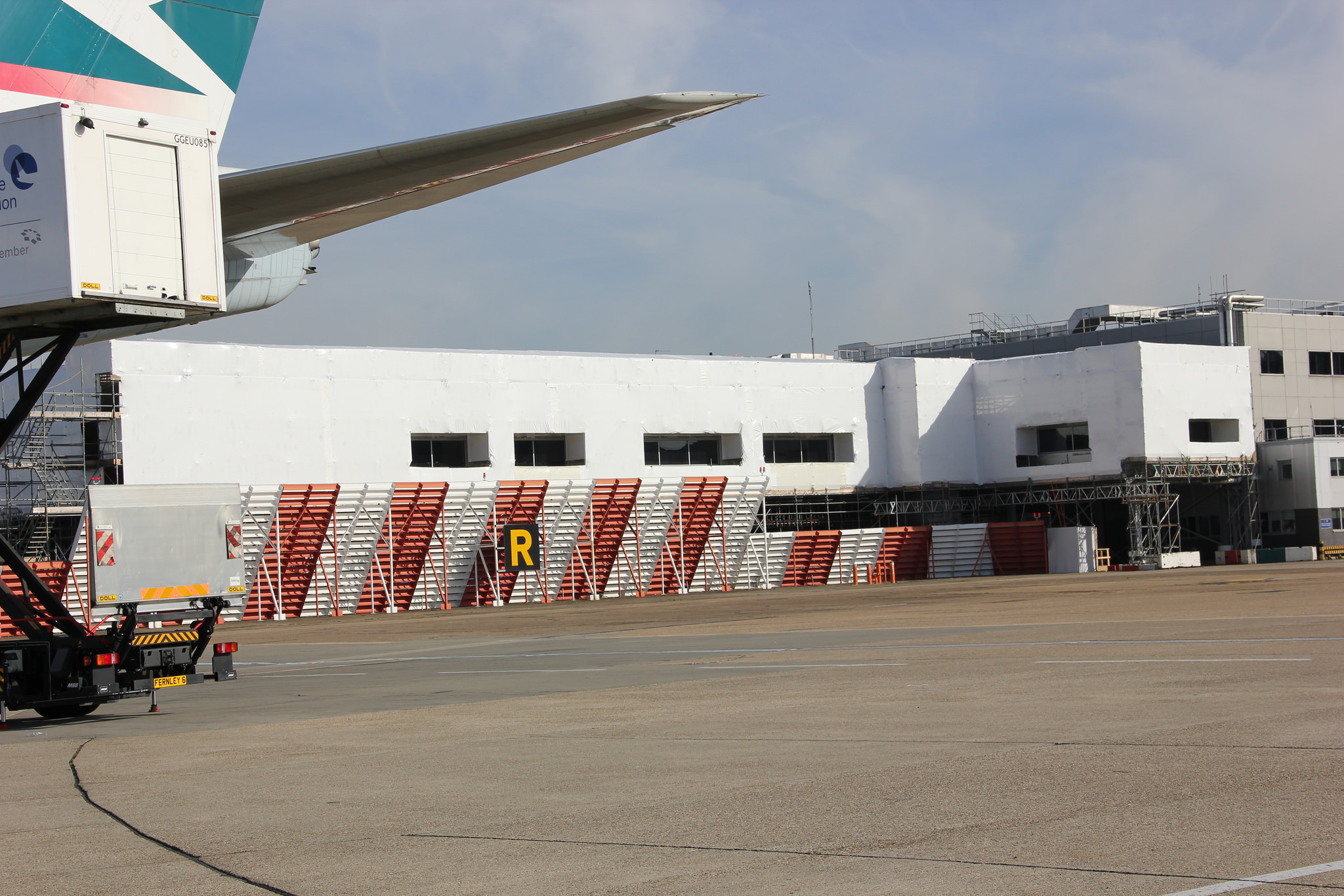 Shrink wrap scaffold sheeting installed at Heathrow Airport
