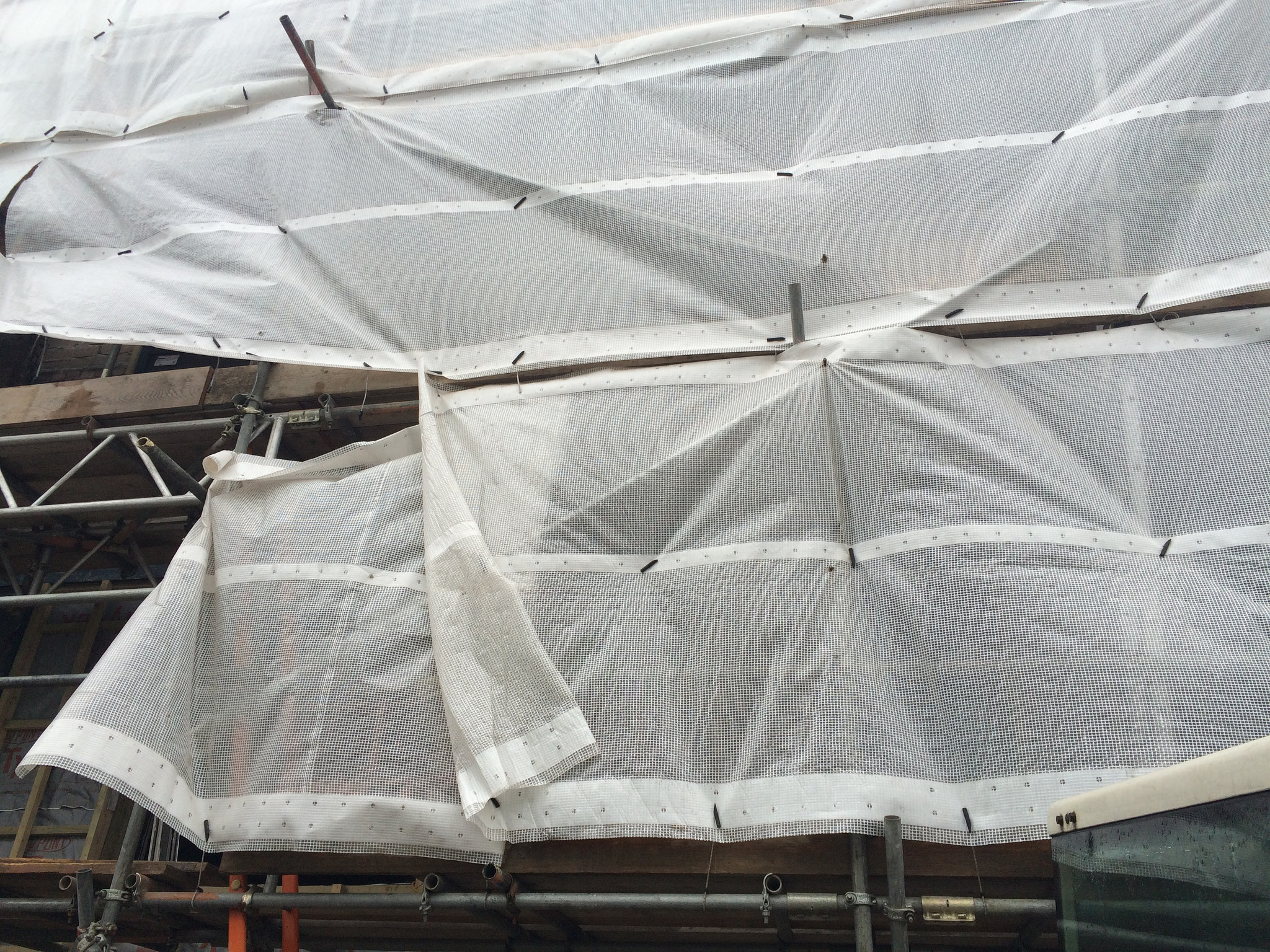 Traditional scaffold containment sheeting