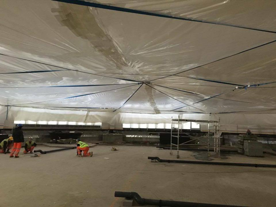 suspended ceiling dust barrier below
