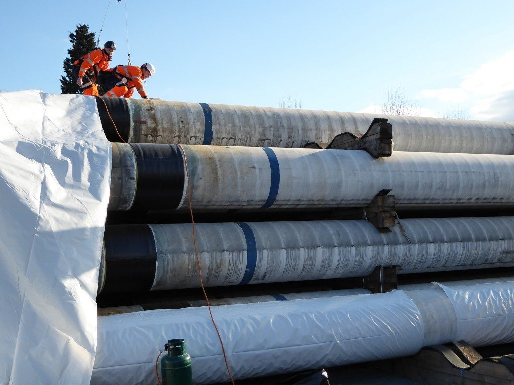 Installing first roll of shrink wrap sheeting