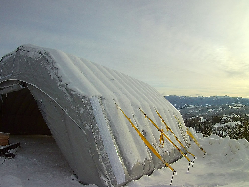 Snow covered construction tent