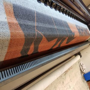 Printed Debris Netting Suitable for Heras Fencing and Scaffolding Close Up Showing Thicker Weave