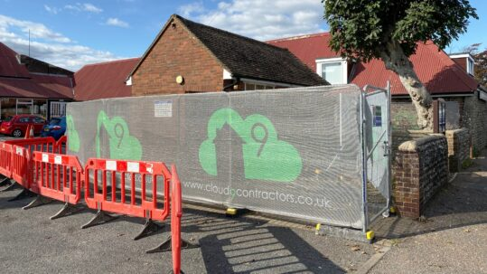 Printed Debris Netting on Heras fencing in front of a building